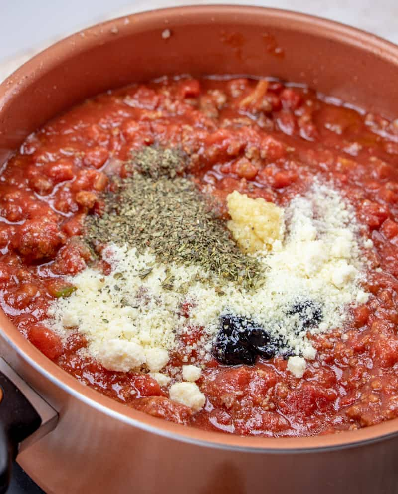 Parmesan cheese, oregano, garlic, grape jelly added to spaghetti sauce mixture