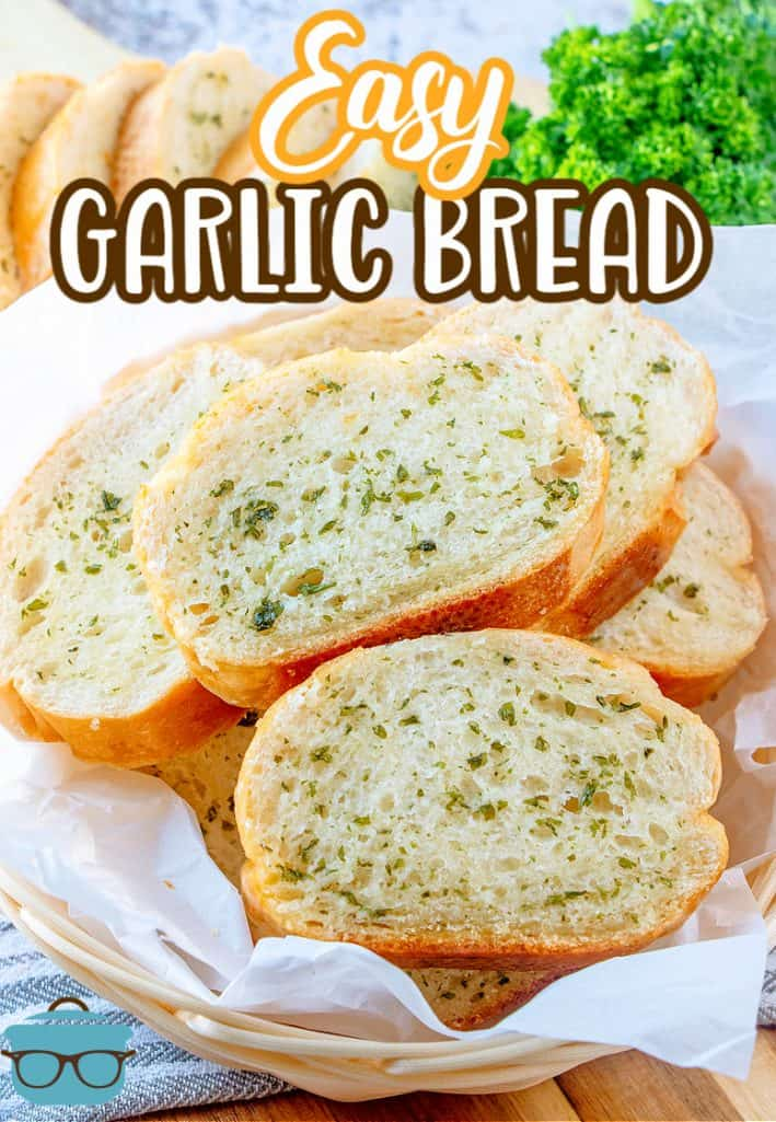 Easy Garlic Bread recipe from The Country Cook, slices of cooked garlic bread shown on a white piece of parchment paper