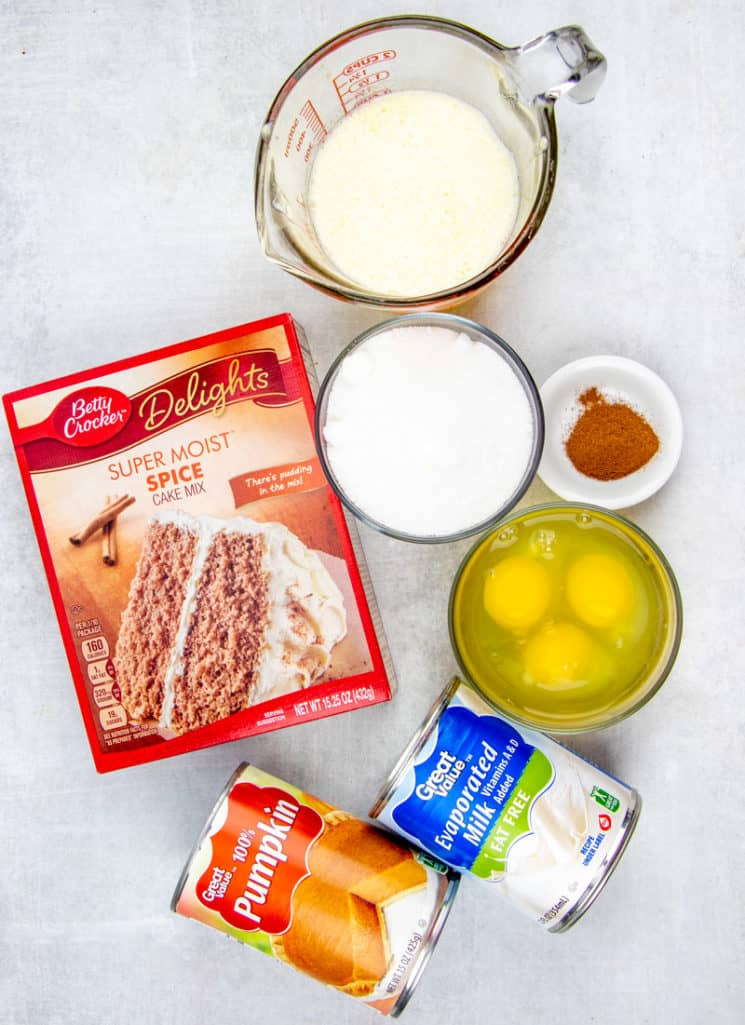 canned pumpkin puree, evaporated, milk, eggs, sugar, ground cinnamon, spice cake mix, butter
