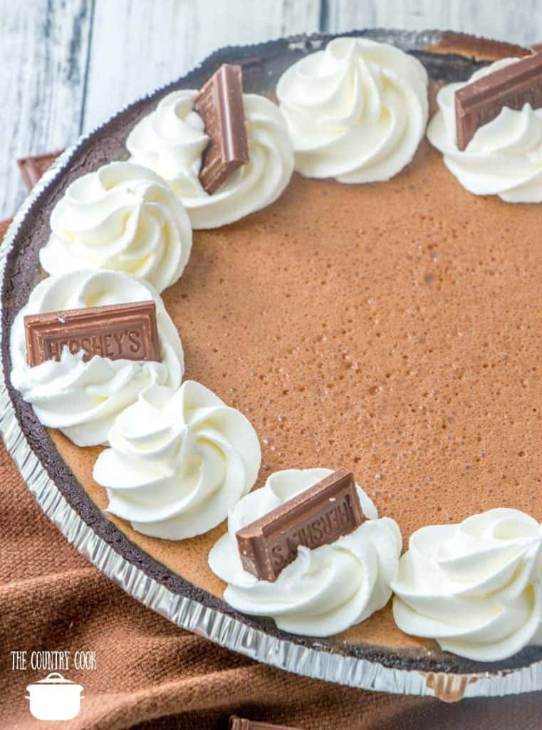 Hershey Chocolate Pie with whipped cream and small chocolate bars