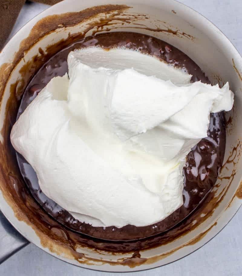 Cool Whip whipped topping added to melted Hershey Chocolate Bars