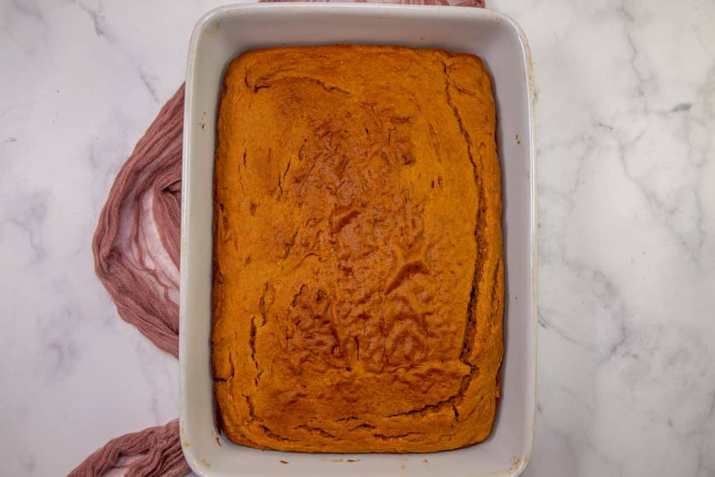 fully baked pumpkin spice cake in a white baking dish
