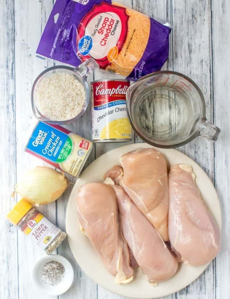 chicken breasts, cream of chicken soup, cheddar cheese soup, long grain rice, shredded cheese, onion, lemon pepper seasoning