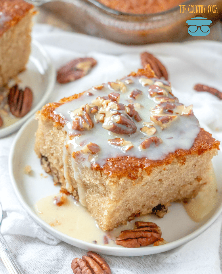 Southern Pecan Praline Cake made with a boxed cake mix and butter sauce