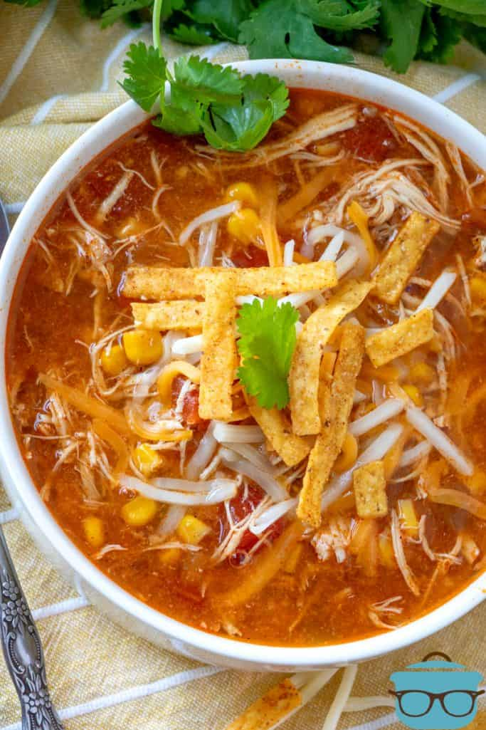 Crock Pot Chicken Tortilla Soup recipe, shown in a small white bowl with an overhead shot of the bowl