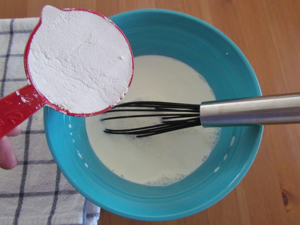 adding flour into half and half milk mixture