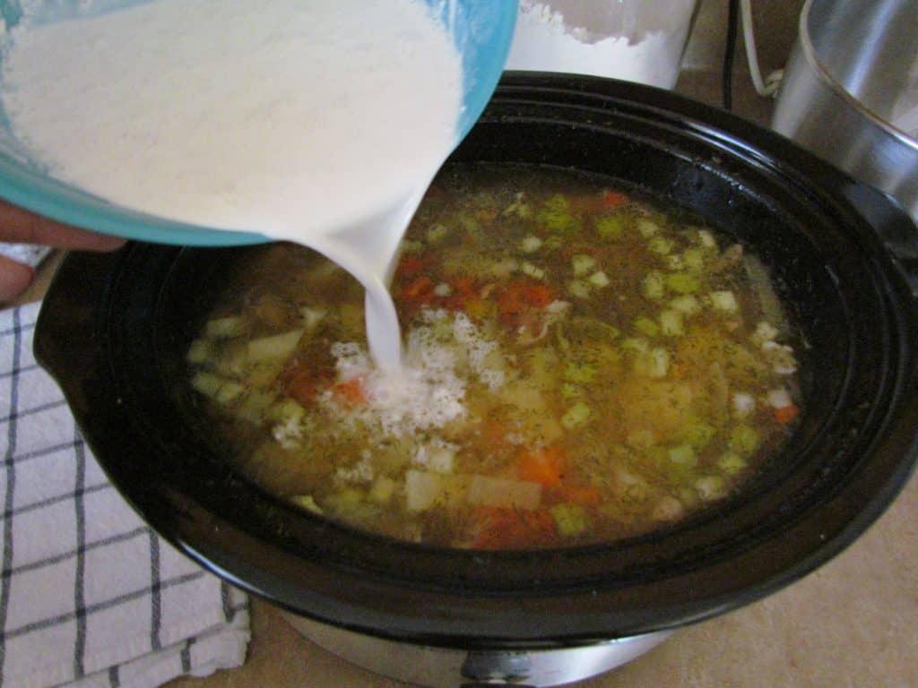 adding half and half into potato leek soup
