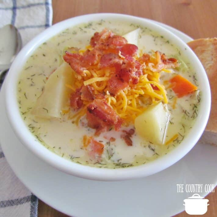 Slow Cooker Leek and Potato Soup topped with shredded cheddar cheese and bacon
