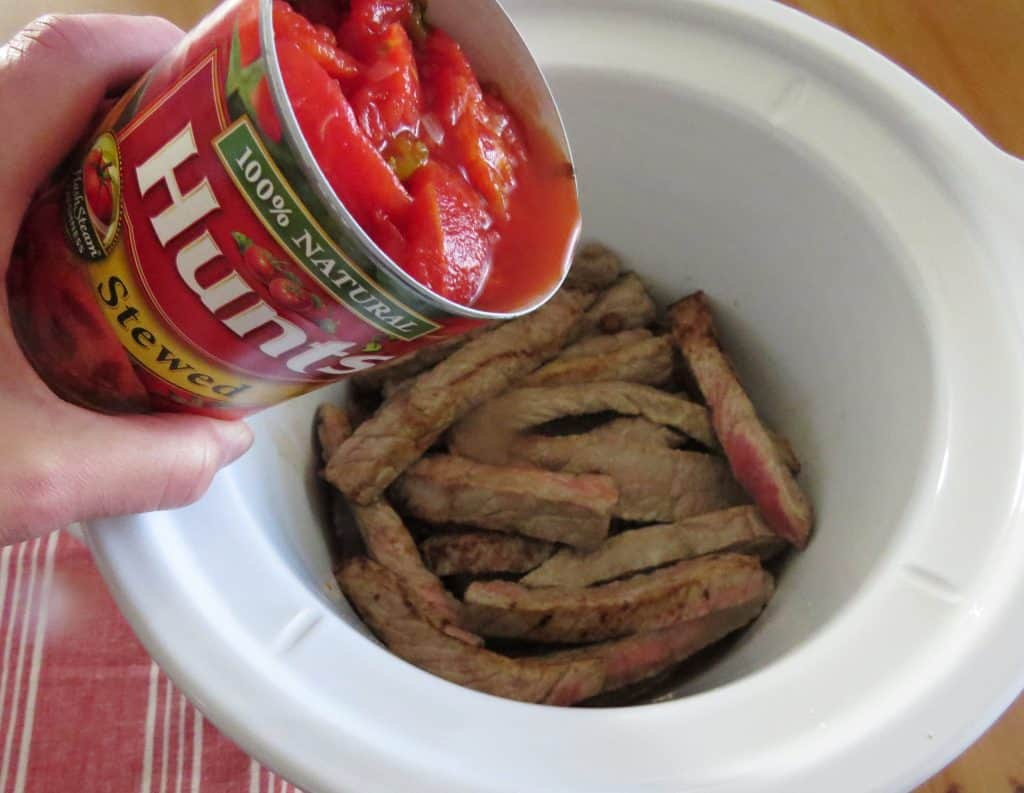 stewed tomatoes and beef strips