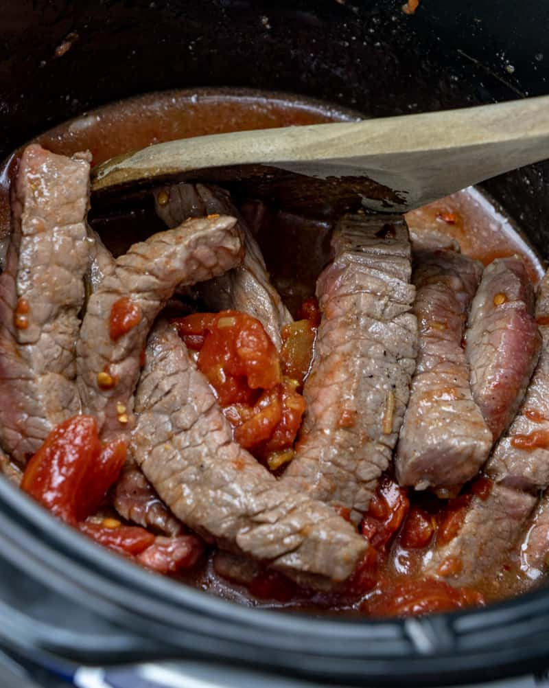 stewed tomatoes, beef strips, beef broth all stirred in a 4 quart slow cooker
