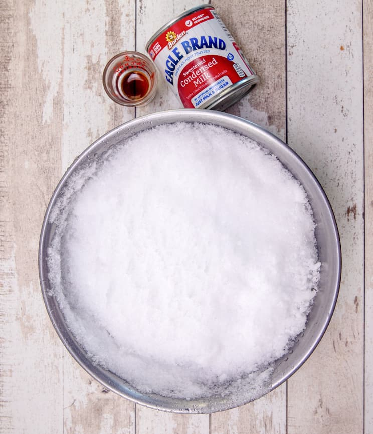 snow cream ingredients: fresh now, sweetened condensed milk and vanilla extract