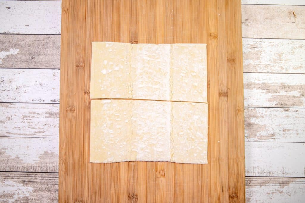 puff pastry shown cut in half and on a cutting board