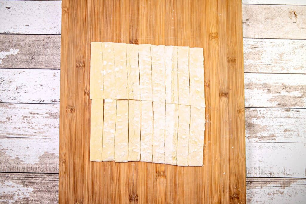 puff pastry shown cut into slices on a wood cutting board