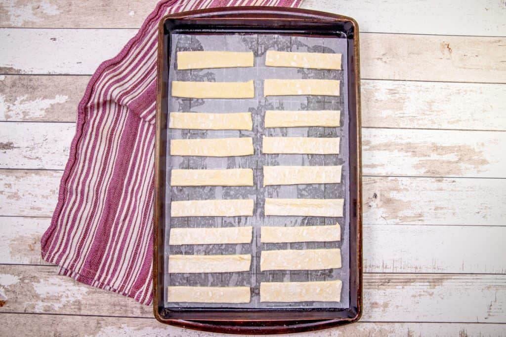 puff pastry strips shown on baking sheet