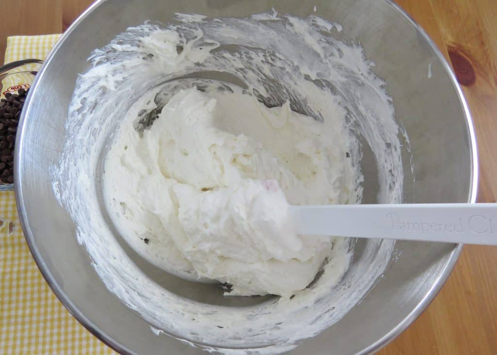 gently folding in Cool Whip to cream cheese mixture