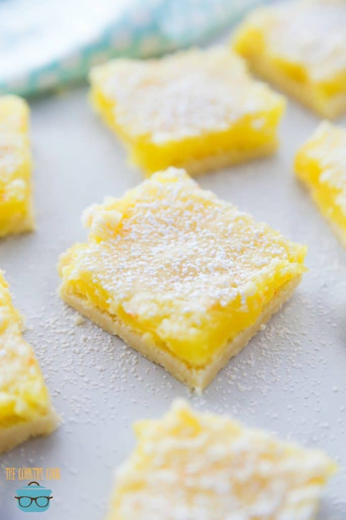 Easy 3-Ingredient Lemon Crumble Bars, sliced, on parchment paper