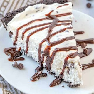 slice, No Bake Chocolate Chip Cheesecake, slice with drizzled chocolate syrup