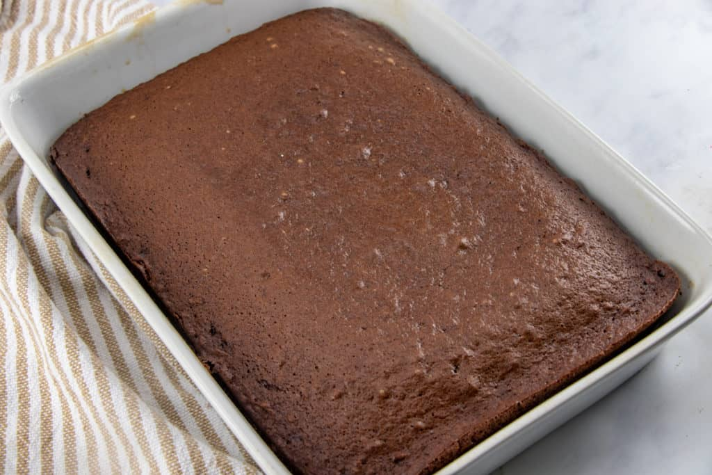 prepared chocolate cake in a 9X13 baking pan