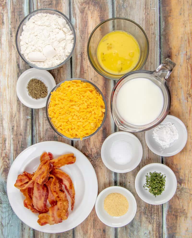 all-purpose flour, baking powder, garlic, dried parsley, black pepper, milk, egg, shredded cheddar cheese, bacon
