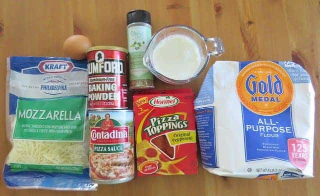 ingredients for Pepperoni Pizza Puffs: all-purpose flour, baking powder, Italian Seasoning, salt, milk, egg ,shredded mozzarella cheese, pepperoni, pizza sauce