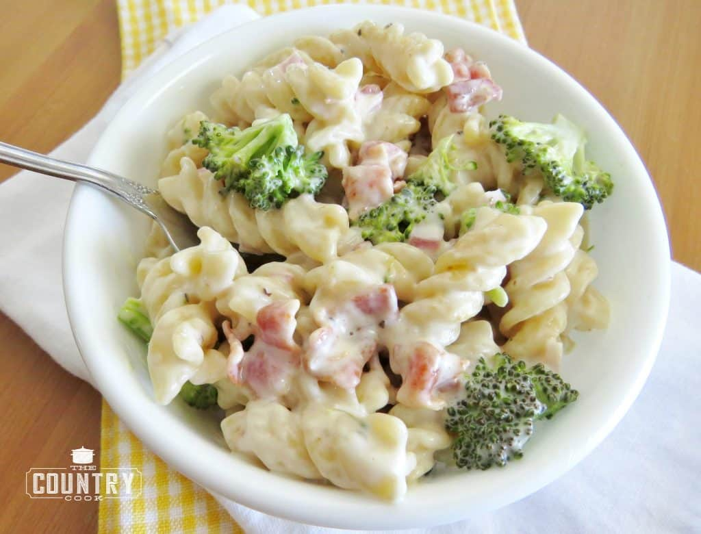 Amazing Pasta Salad with rotini pasta, broccoli florets, cooked bacon in a homemade sweet and sour dressing
