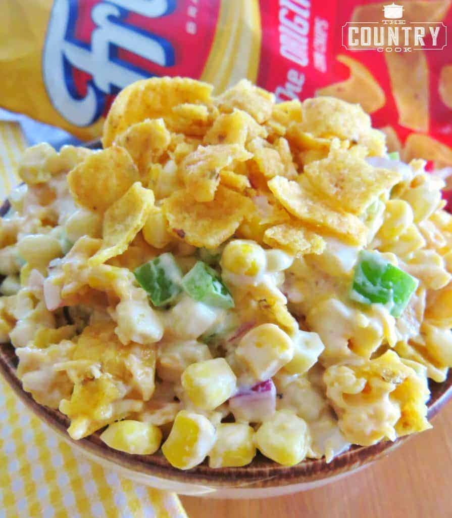 Frito Corn Salad recipe shown in a bowl with Fritos product bag in the background