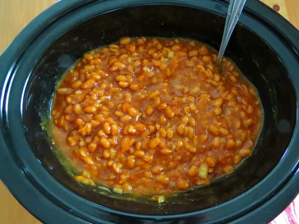 Baked Beans stirred in an oval crock pot