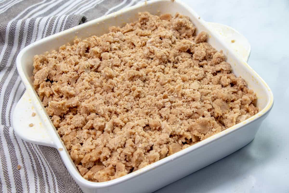 brown sugar crumbs sprinkled on top of cake batter