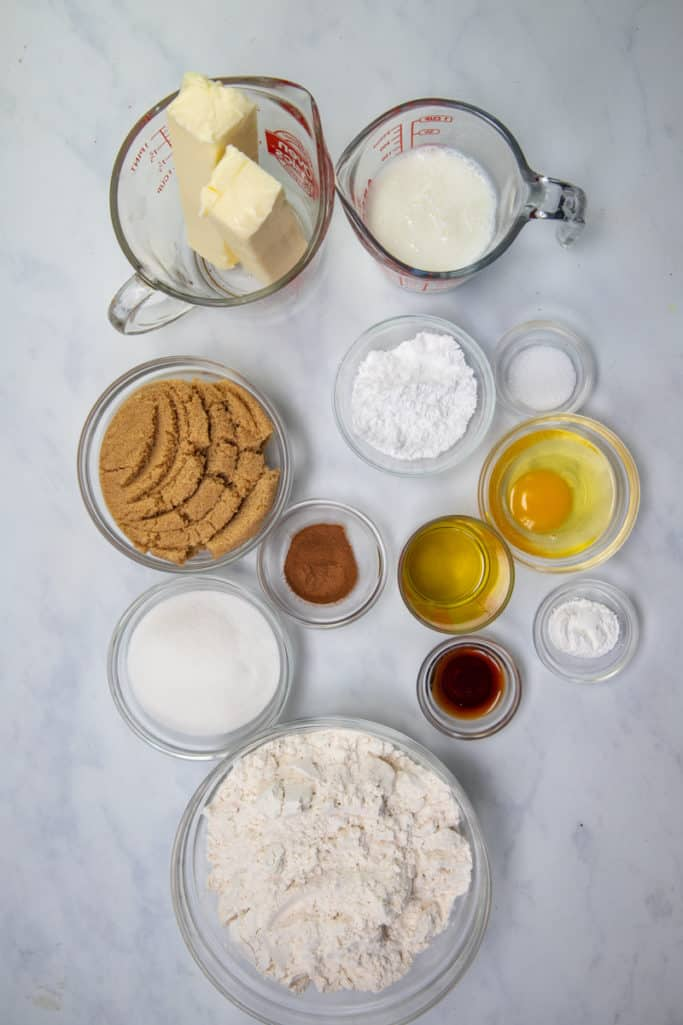 all-purpose flour, sugar, baking powder, salt, large egg, buttermilk, canola oil, vanilla extract, light-brown sugar, cinnamon, salted butter, powdered sugar