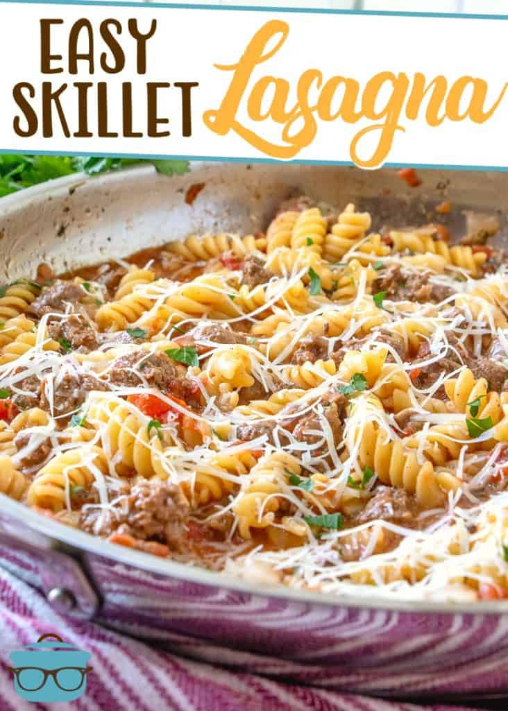 Easy Skillet Lasagna Dinner recipe from The Country Cook, shown pictured in a large skillet and topped with shredded Parmesan cheese