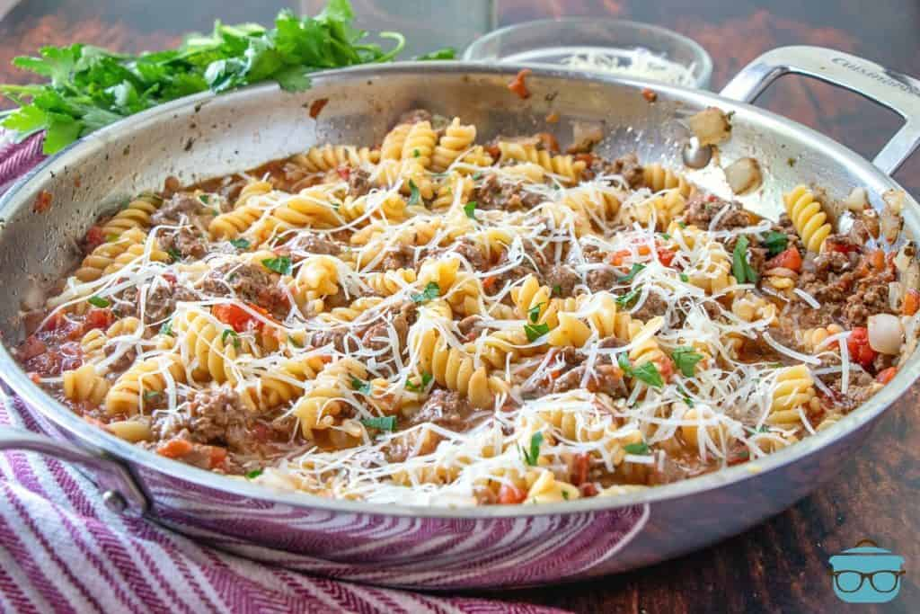 Easy Skillet Lasagna Recipe, shown in a large skillet pan with parsley on the side