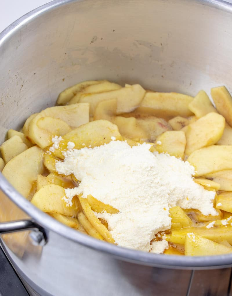 water and vanilla pudding added to sliced apple mixture in large sauce pan.
