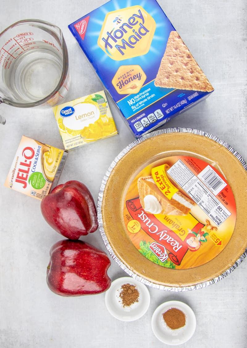 graham cracker crust, apples, lemon jello, vanilla pudding, water, cinnamon, nutmeg.