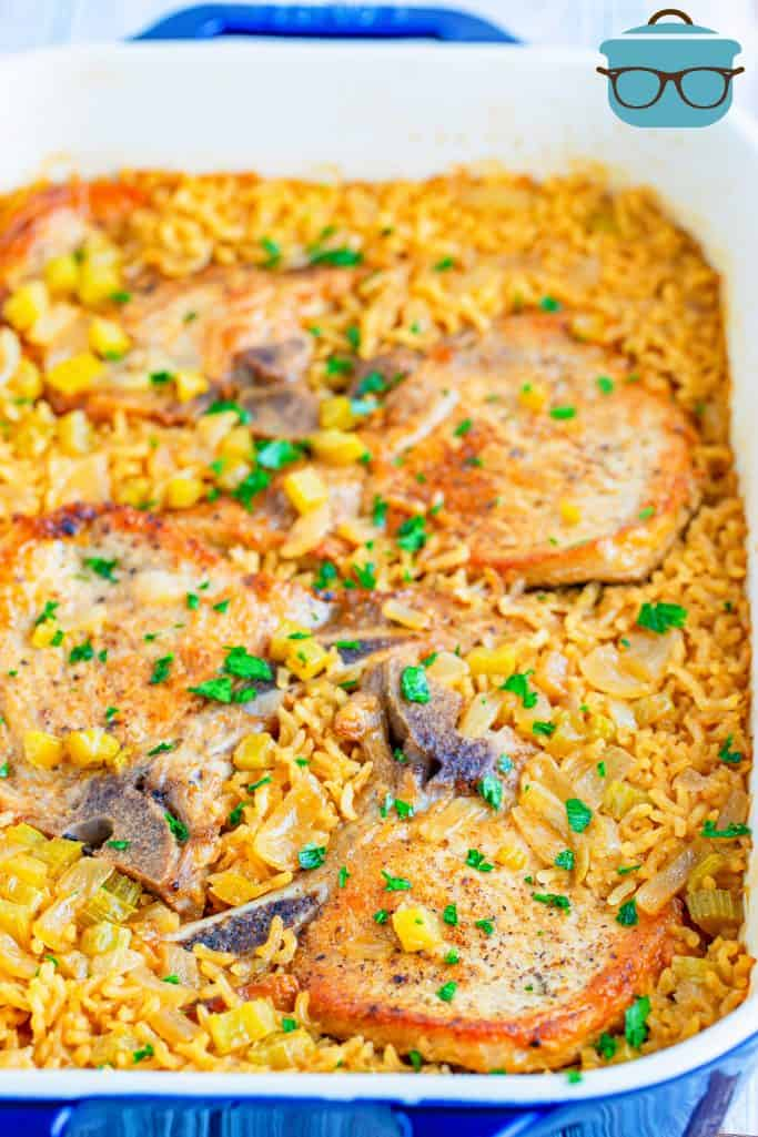 rice and pork chops shown fully baked in a baking dish