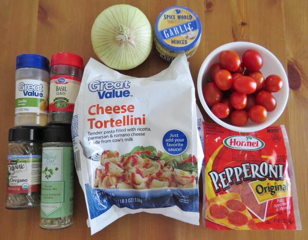 olive oil, onion, minced garlic cloves, grape tomatoes, pepperoni, dried basil, dried oregano, Italian seasoning, garlic powder, cheese tortellini pasta, Parmesan cheese