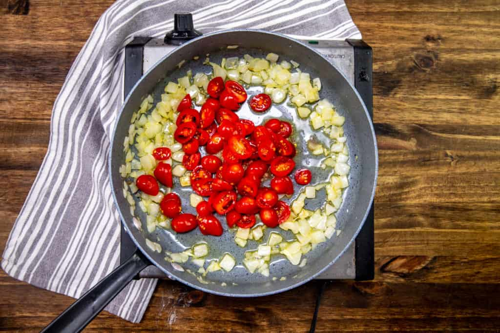 minced garlic and slice grape tomatoes added to skillet with cooked onions and olive oil