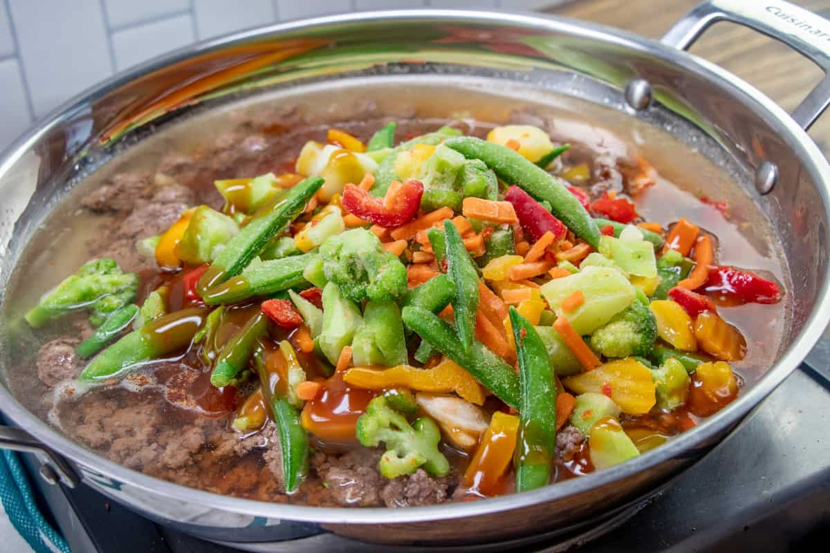 water, cooked ground beef, frozen stir fry vegetables and stir fry sauce in a large skillet.