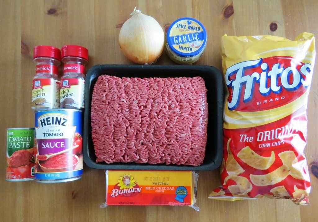 ground beef, tomato sauce, cumin, chili powder, onion, garlic, Frito corn chips