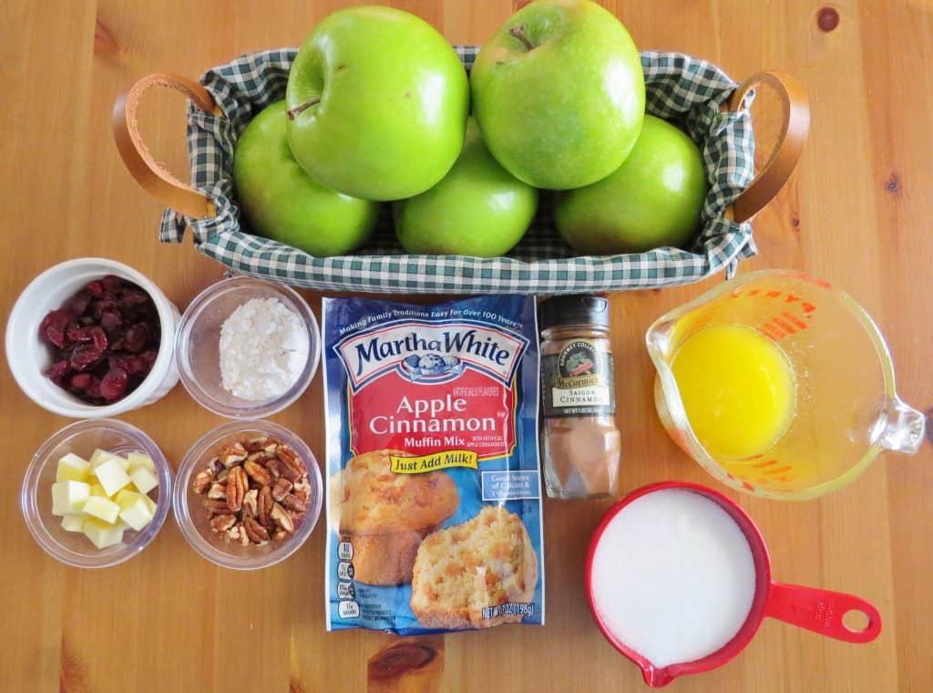 green apples, dried cranberries, sugar, flour, ground cinnamon, butter, Martha White Apple Cinnamon Muffin Mix, chopped pecans