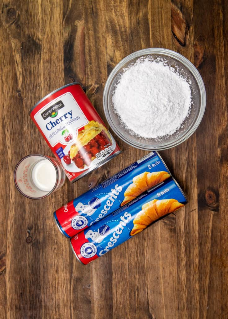 crescent roll dough, cherry pie filling, powdered sugar, milk
