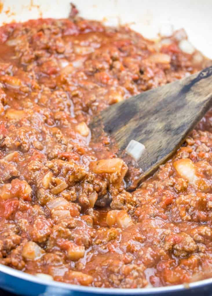 crushed tomatoes, tomato sauce added to ground beef in pan