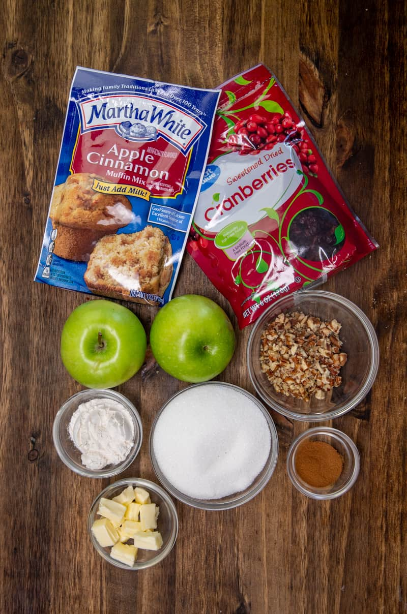 ingredients needed: green apples, dried cranberries, sugar, flour, ground cinnamon, butter, Martha White Apple Cinnamon Muffin Mix, chopped pecans