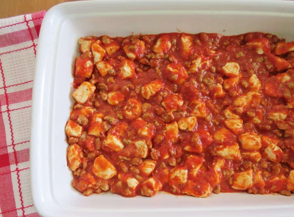 spread bubble up pizza mixture into 9x13 baking dish