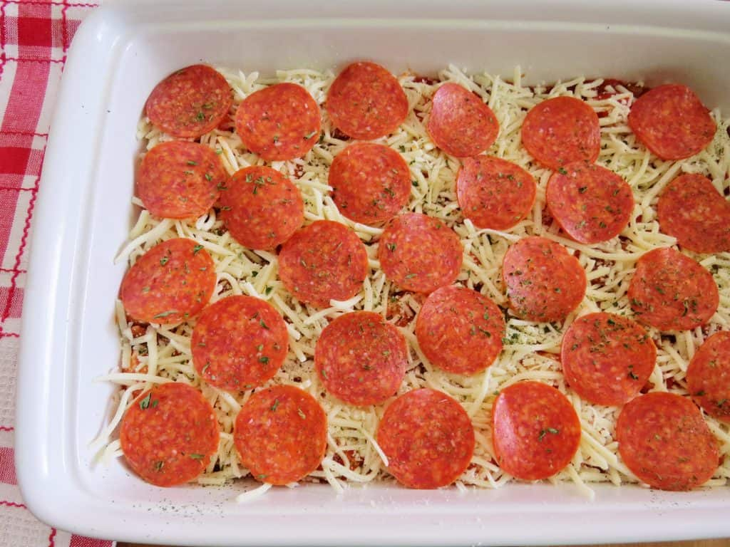 pre-baked, pizza biscuit casserole topped with cheese and pepperoni in a white baking dish