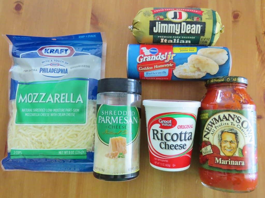 Bubble Up Lasagna ingredients: Italian sausage, spaghetti sauce, ricotta cheese, Parmesan cheese, Pillsbury Grands Jr. Biscuits, mozzarella cheese