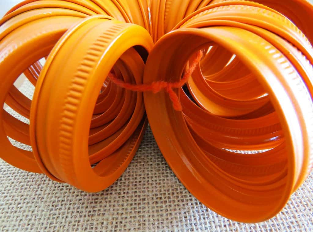 tied string, orange mason jar lids, craft