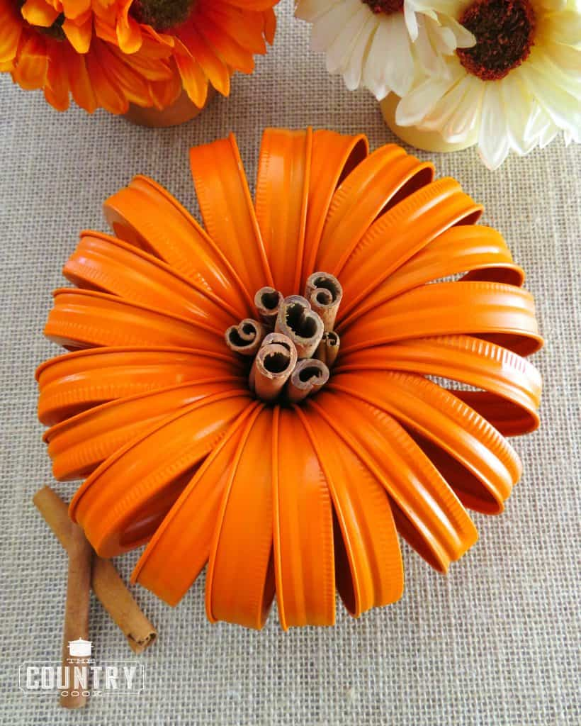 Mason Jar Lid Pumpkins with Cinnamon Stick Stem