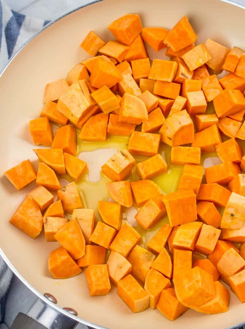 diced fresh sweet potatoes combined with oil in a large skillet.
