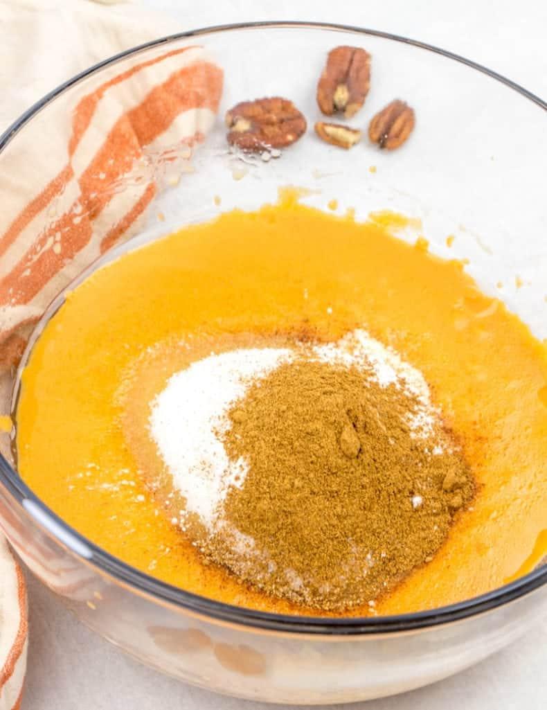 sugar, baking powder, pumpkin pie spice combined in a bowl