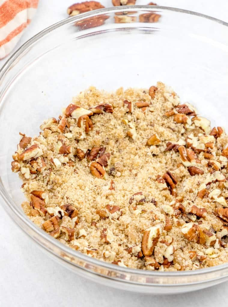 melted butter, brown sugar, chopped pecans, cinnamon, flour mixed together in a bowl